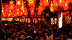 Crowds admire a lantern display in the Yuyuan Gardens in Shanghai