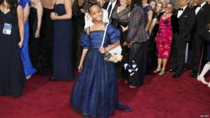 Quvenzhane Wallis arrives on the red carpet at the Oscars.