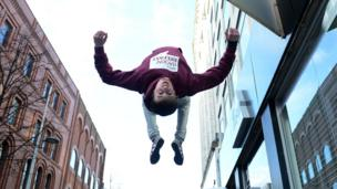 Free runner doing a backflip