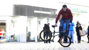 Man standing on BMX pedal