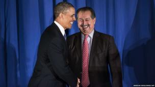 US President Barack Obama is greeted by Business Council chairman Andrew N Liveris