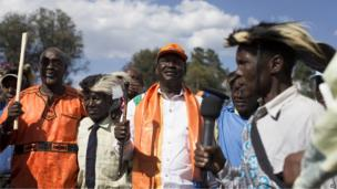 Kenyan Prime Minister and presidential candidate, Raila Odinga, middle, takes part in a traditional dance at a rally held in Kapkatet in Kenya (22 February 2013)
