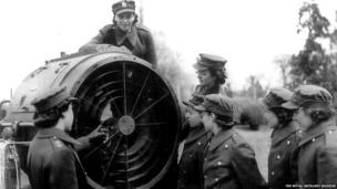 Archive photograph of capped women with searchlight