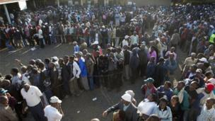 Voters wait in line to cast their ballots in a school yard in the Mlango Kubwa ward of Nairobi, March 4, 2013.