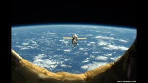 An unpiloted ISS Progress resupply vehicle approaches the International Space Station