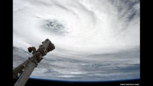 Eye of the Storm - Tropical Cyclone Haruna, over Madagascar, with Canadarm2 pointing at the eye