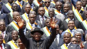 Nigeria's President Goodluck Jonathan waves as he poses with members of Ivory Coast's parliament during a visit to Abidjan on 2 March 2013