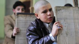 Libyan boys hold wooden slates as they memorize the Koran at a school in Benghazi, Libya, on 4 March 2013