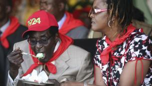 Zimbabwe's President Robert Mugabe eats cake next to his wife Grace during an event marking his 89th birthday in Bindura, north of Harare, on 2 March 2013