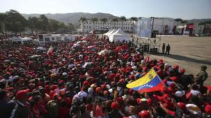 People gather outside the military academy where the funeral ceremony for Venezuela's late President Hugo Chavez will take place in Caracas, Venezuela