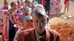 Masai wait to cast ballot papers outside a polling station during the presidential and parliamentary elections near the town of Magadi, south of Nairobi.