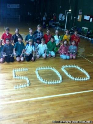 Youngsters in Guernsey mark the 500-day milestone with shuttlecocks at a badminton lesson