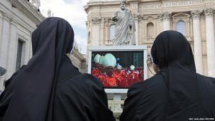 Nun pray while cardinals hold the mass