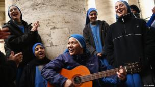 Nuns sing hymns under the colonnade in St Peter's Square in Vatican City.