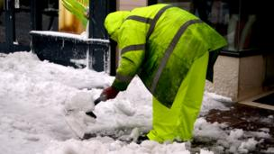 Parish of St Helier worker clearing snow