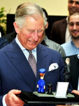 Prince Charles is shown model of himself with Postman Pat