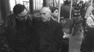 Argentine Cardinal Jorge Mario Bergoglio talks with a man as he rides the subway in Buenos Aires, Argentina, in 2008