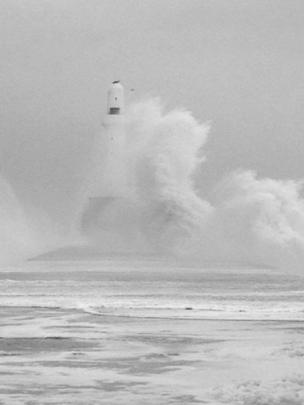 Waves crashing over Aberdeen lighthouse