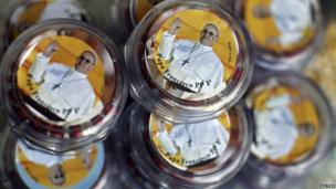 Picture of Pope Francis on lids of packaged prayer beads in tourist shop at Vatican
