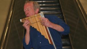 John Smith plays the panpipes