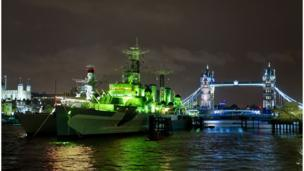 HMS Belfast on the River Thames in London has donned a coat of green