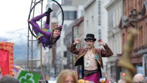 Trapeze artist and stilt walker