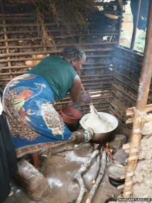 Cooking the staple food Nshima