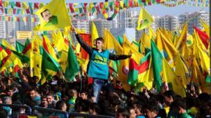 A Kurdish man waves a poster of founder of PKK (Kurdish Worker Party) Abdullah Ocalan during celebrations of Nowruz,