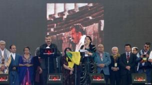 Pro-Kurdish politicians Sirri Sureyya Onder (3rd L) and Pervin Buldan (6th R) read the statement of Ocalan