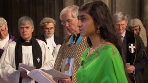 Evangeline Kanagasooriam questions the Archbishop as he enters the cathedral.