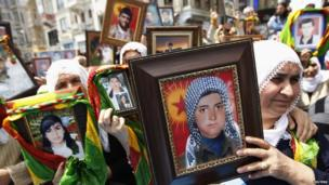 Turkish Kurdish women hold pictures of their loved ones who were killed in clashes between Kurdistan Workers Party (PKK) guerrillas and Turkish security forces, during a demonstration in central Istanbul in this May 18, 2011 file photo
