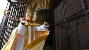 Archbishop Welby enters the Cathedral by knocking three times