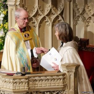 The archbishop being installed on the diocesan throne by the Venerable Sheila Watson