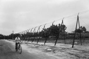 Indo Bangladesh border on the Indian side. Most of the roughly 2400 mile long border is barbed.