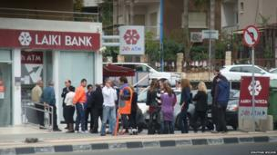 People queue at a cash point in Cyprus. Photo: Jonathan Wilson
