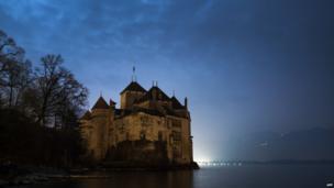 Chillon castle on the edge of Lake Geneva, seen during Earth Hour