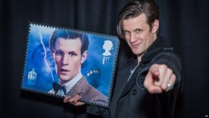 Matt Smith holding a Doctor Who stamp