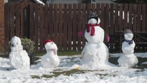 Meet a full snow family - what other way to use a garden full of the white stuff?