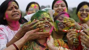 """Indian women celebrate """"Holi"""", the Indian festival of colours in Allahabad, India,"""