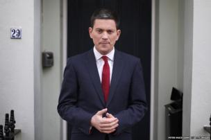 Former Foreign Secretary David Miliband talks to reporters at his home