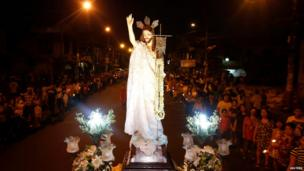 A procession of the risen Christ, on Easter Sunday at a church in Mandaluyong City, Manila, the Philippines.