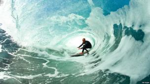 Surfer Ian Battrick in the curl of a wave