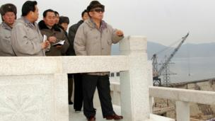 A handout KCNA photo released 07 January 2008 shows an undated picture of Kim Jong-il inspecting the construction site on a hydro-electric power plant near Kaesong.