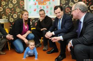 Britain's Chancellor George Osborne meets parents and toddlers at Daisy Day Nursery in Cardiff
