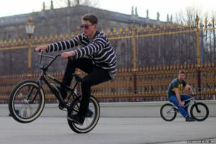 French BMX enthusiast Benjamin Dauce (left) practises on his freestyle BMX