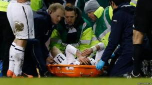 Tottenham Hotspur's Gareth Bale is treated for an injury during the Europa League quarterfinal first leg soccer match against Basel at White Hart Lane, London