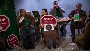 Members of the Mortgage Victims' Platform occupy a branch of Bankia in Barcelona, Spain