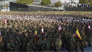 Soldiers and police attend a ceremony in honour of their fallen comrades.