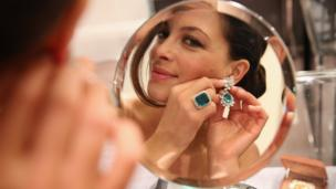 A model at Sotheby's auction house in London wears jewellery