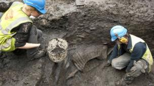 Archaeologists dig at the site in London